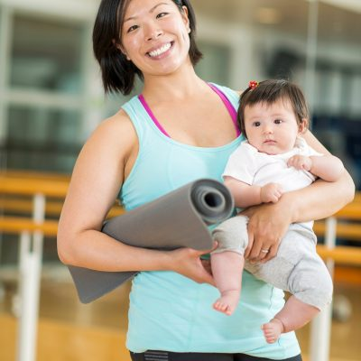 Moms and babies in gym doing exercise