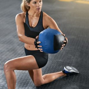 Full length shot of a young woman working out with a medicine ball at the gymhttp://195.154.178.81/DATA/i_collage/pi/shoots/806226.jpg